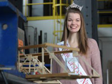 Emily Mahana with engineering project and wearing tiara and sash
