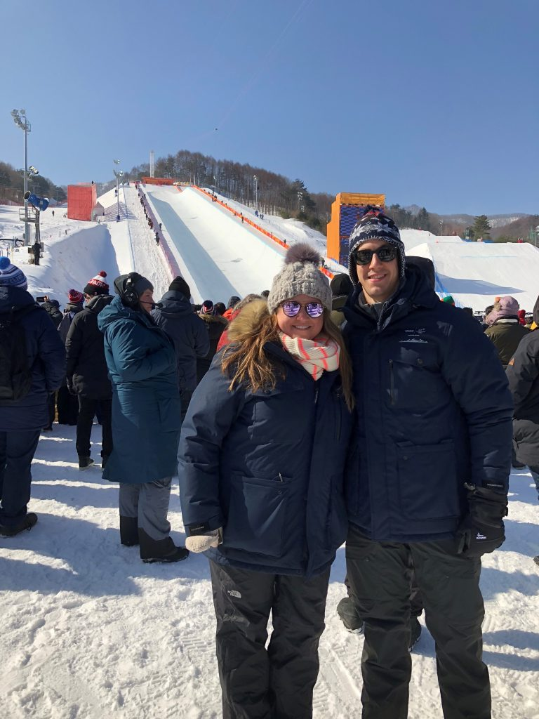 two people standing in front of ski area