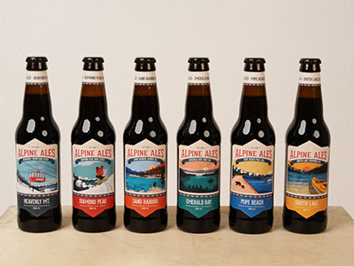 Six bottles of Alpine Ale with varying designs