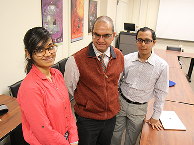 Graduate student Pranika Jain, College of Engineering & Computer Science Professor Chilukuri Mohan and graduate student Siddhartha Roy Nandi, from left