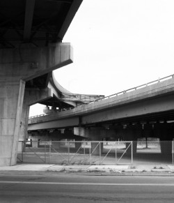 An underpass of Interstate 81 in black and white