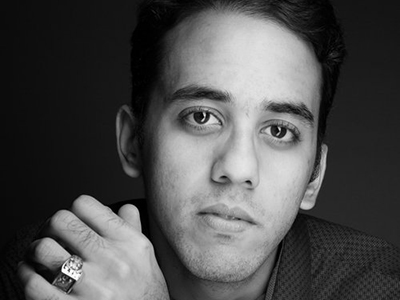Lenny Martinez face and hands in black and white