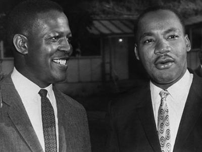 Martin Luther King Jr., right, and Professor Charles Willie during King's 1965 visit to the Syracuse University campus.