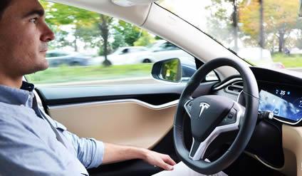 Bob Sorokanich at the steering wheel of the Tesla 3