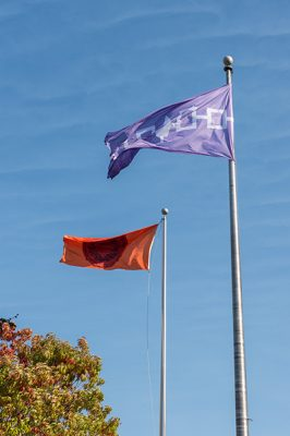 The Haudenosaunee flag flies alongside the SU Flag on the Quad.
