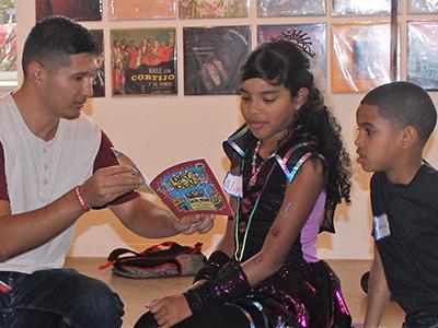 Martin Alberto Gonzalez, left, with children during a Reading Circles workshop at La Casita