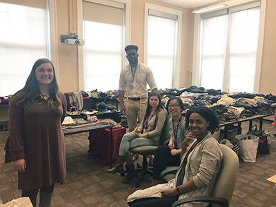 Students at the 2018 Trans Support Day, surrounded by clothes collected during the clothing drive.