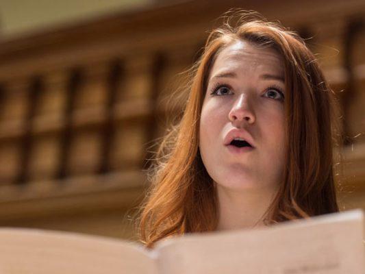 University singer rehearsing.