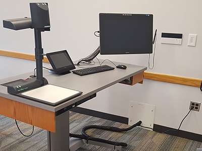 Instructor's desk with technology setup.