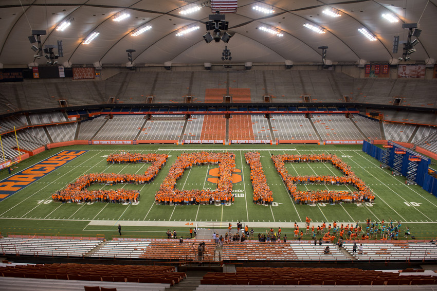 crowd of students form numbers 2018 on Carrier Dome field