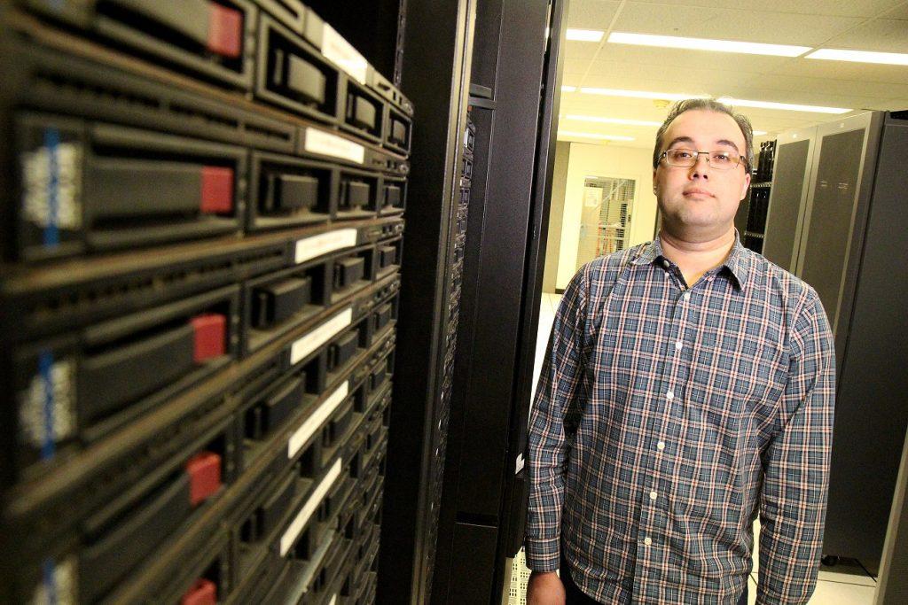 man standing in front of computer servers