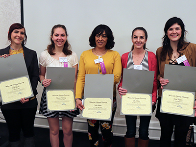 five award winners with their awards