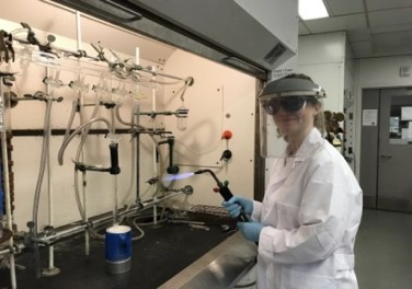 woman working with blowtorch in lab