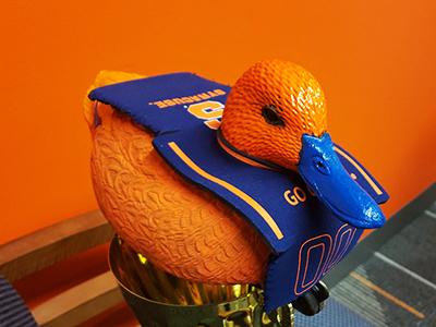 plastic duck painted orange with SU regalia