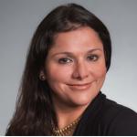 Rosalinda Vasquez Maury in front of grey backdrop