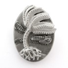 black and white photo of pin with illustration of crinoid