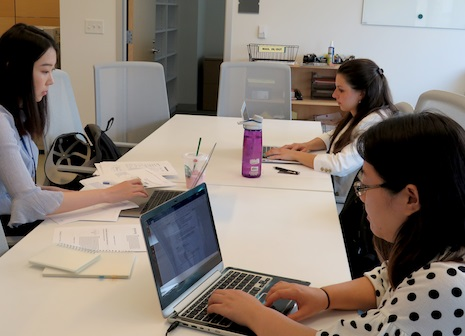students typing on computers