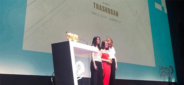 Newhouse advertising student Emily Alek accepting the Cannes Future Lion at the Cannes Lions International Festival of Creativity in Cannes, France from Group Creative Director Michelle Lassman and Head of Technology Jo Hickson from AKQA—the global digital ad agency that sponsors the Cannes Future Lions awards.