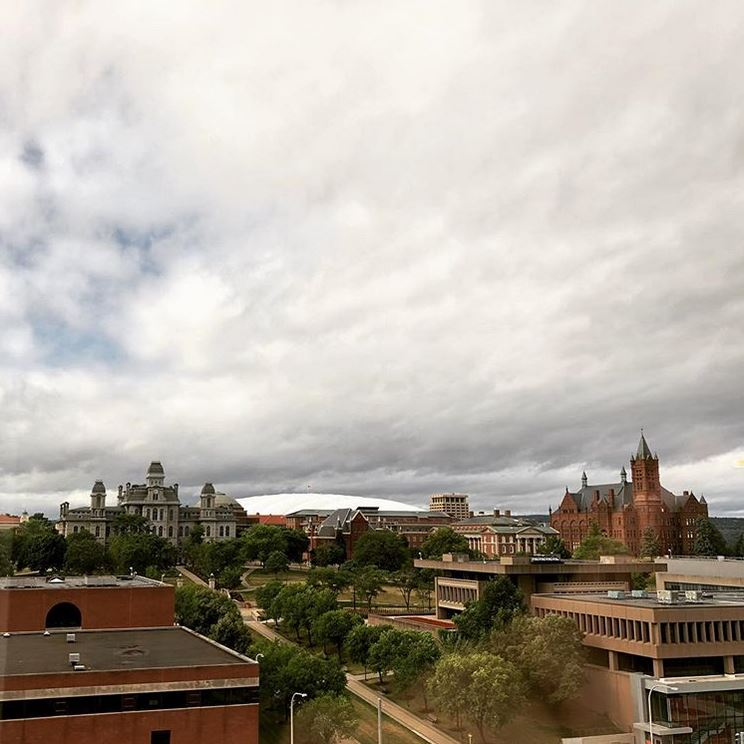 clouds passing over campus buildings