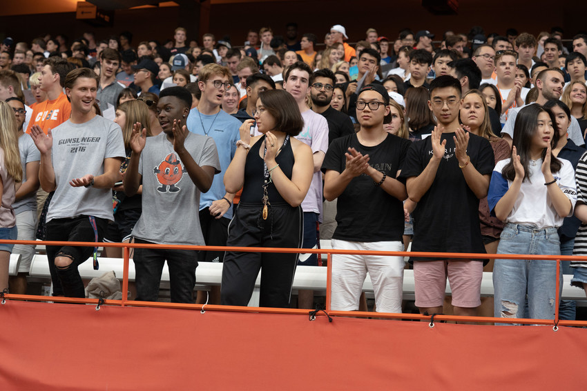 students stand in the bleachers at the Dome