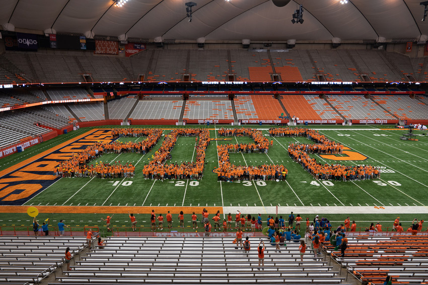 the number 2022 is formed by people on the Dome floor