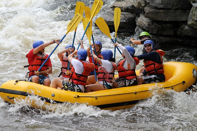people rafting on boat