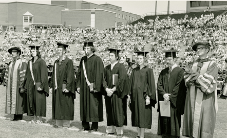 students standing at graduation