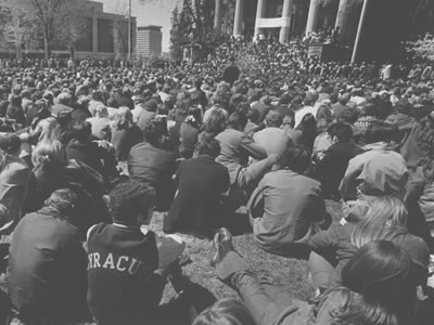 old photo of students sitting on quad