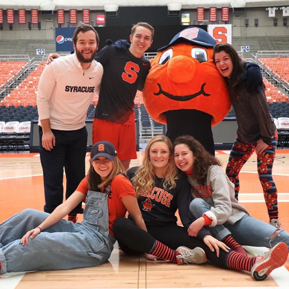 Students on the Otto mascot team pose with Otto in the Dome