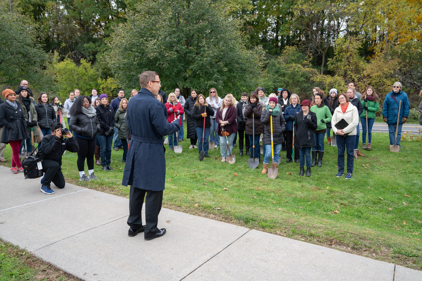 The Rev. Brian Konkol, dean of Hendricks Chapel, offers a blessing before the tree planting on South Campus.