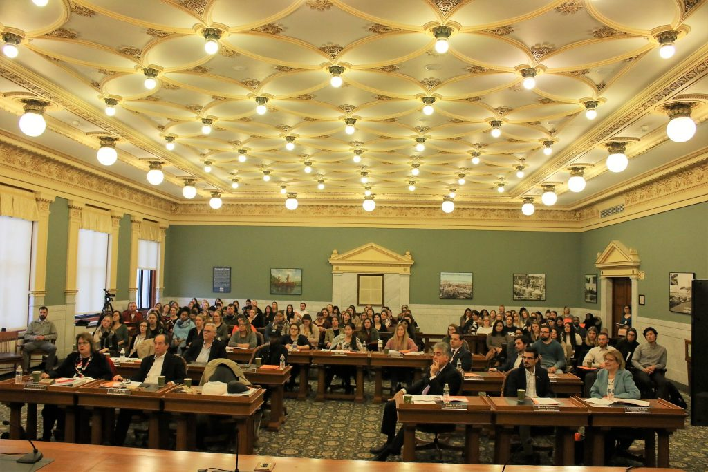 Audience for the 20th Stone Policy Symposium in the Onondaga Count Legislature chambers.