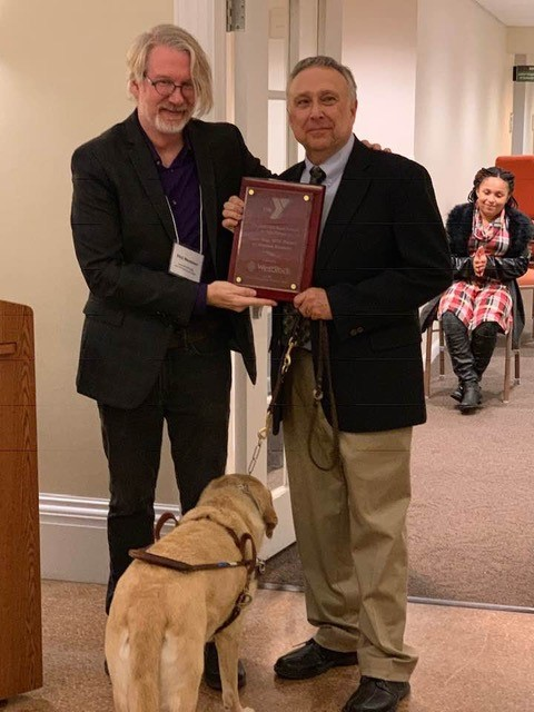 Stephen Kuusisto (right) with Phil Memmer, executive director of the Arts Branch of the YMCA of Greater Syracuse, and Corky.