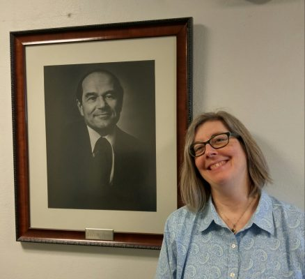 Diane Wiener, with a portrait of Burton Blatt