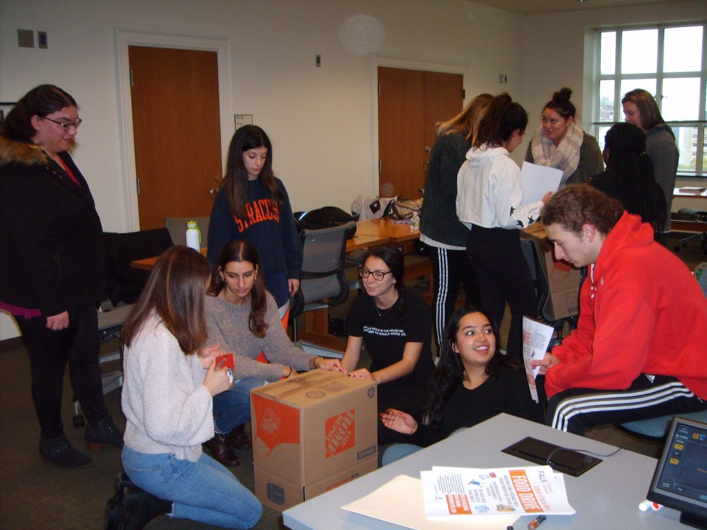 Social Work students assemble donation boxes for 2018 food drive