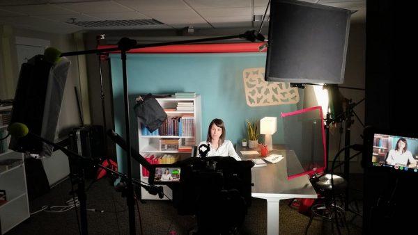 Behind the scenes photo of recording in studio