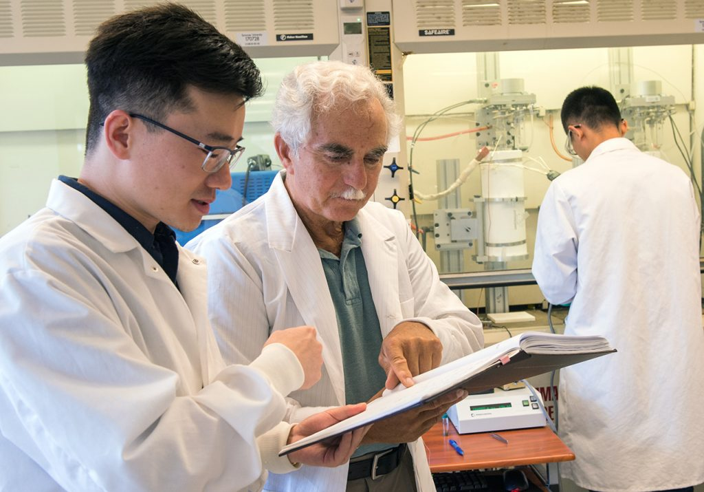 Professor Lawrence Larry Tavlarides (center) with students in his lab.