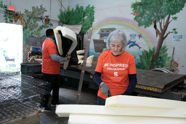 Volunteers assembling matresses.