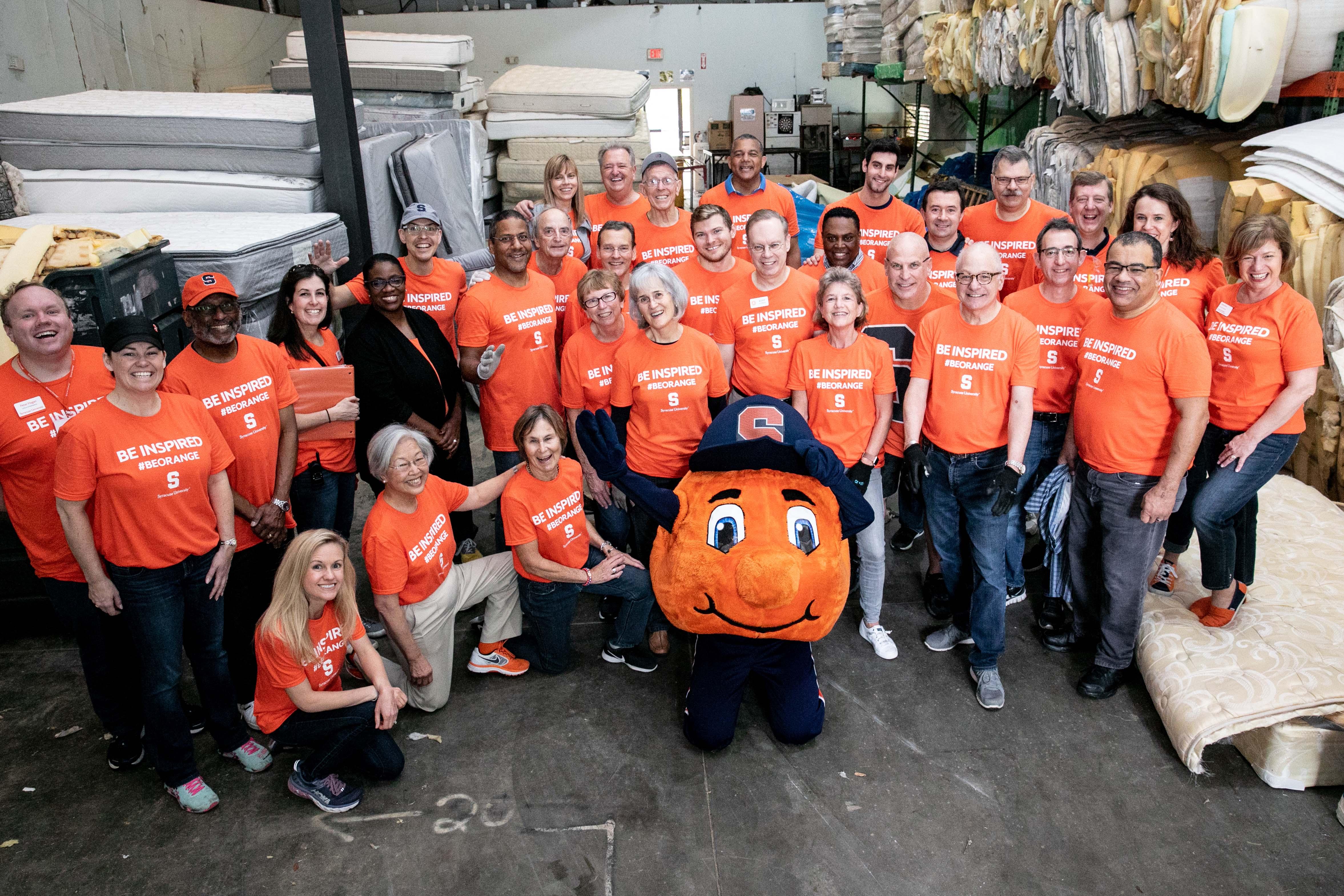 Orange volunteers at The Mustard Seed.