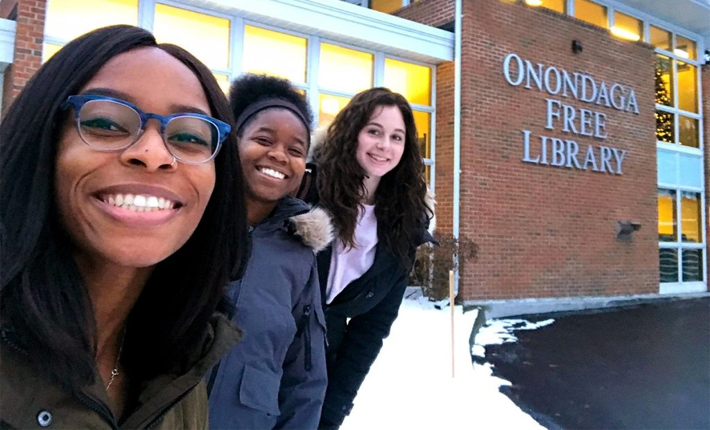 iSchool seniors Kahssia Hills, Malaika Howard and Sydney Paul outside the Onondaga Free Library, where they helped start a new chapter of Girls Who Code.
