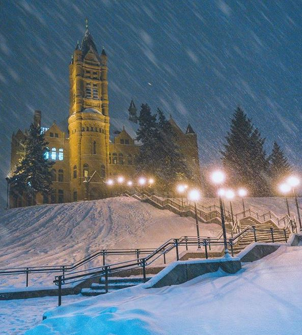 snow falling on Crouse College