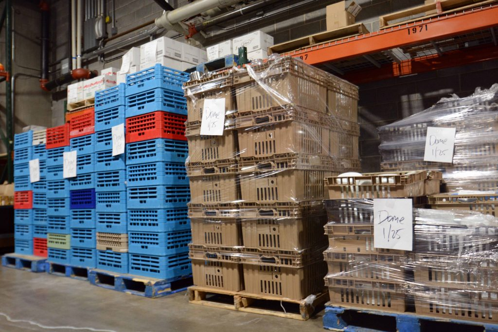 Pallets of prepared food waiting at the Commissary for delivery to the Dome. (Photo by Keone Weigl)