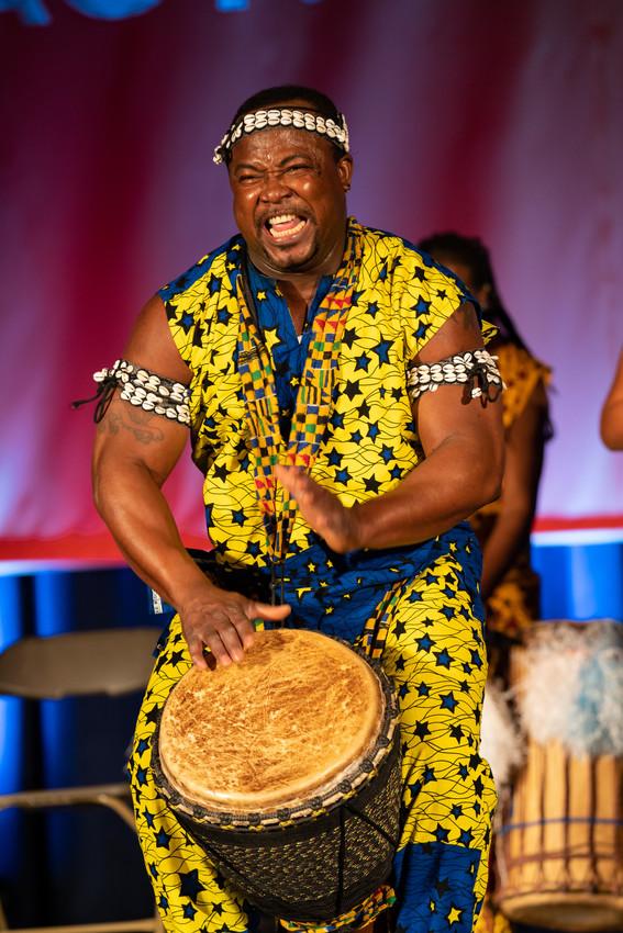man striking drum