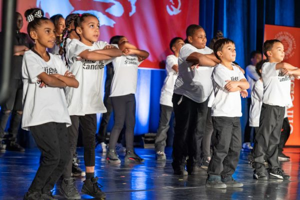 group of children dancing on stage