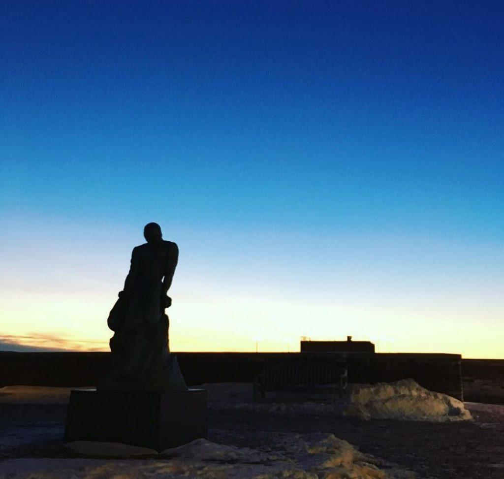 statue overlooking sunset