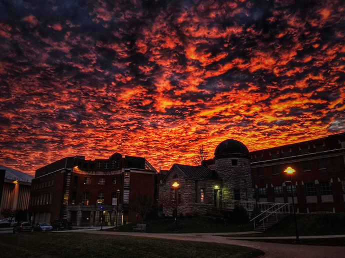 sunset over campus buildings