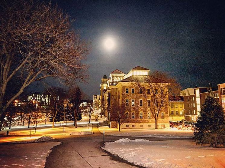 moon shining over buildings