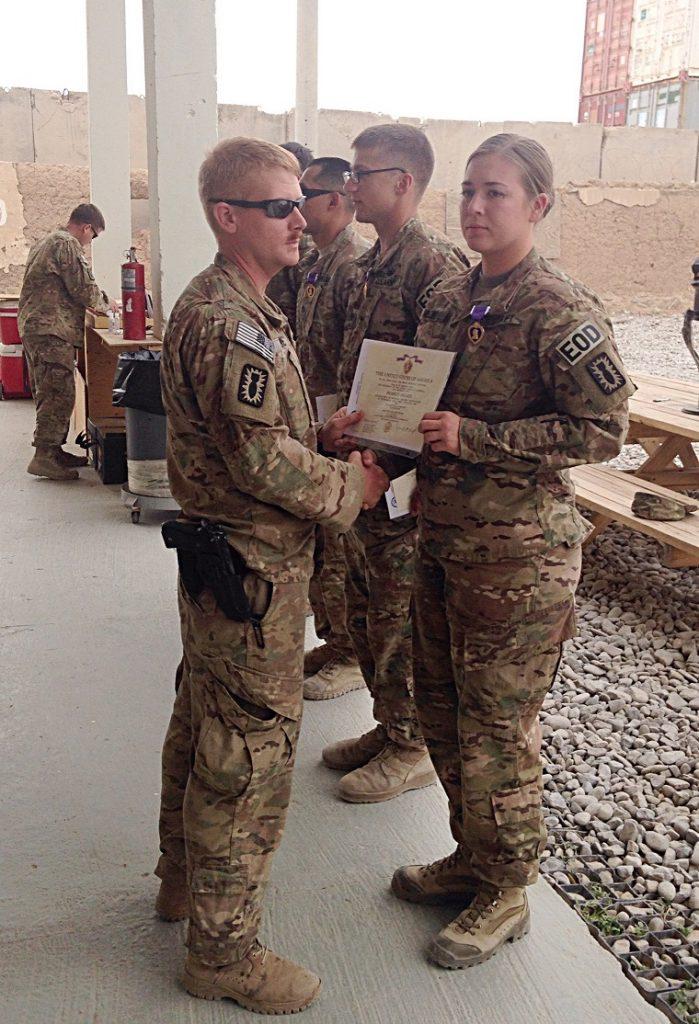 man handing woman certificate