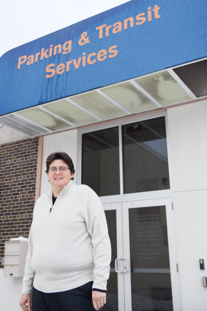 Deanna (Dee) Bailey outside the Parking and Transit Services office at Skytop.