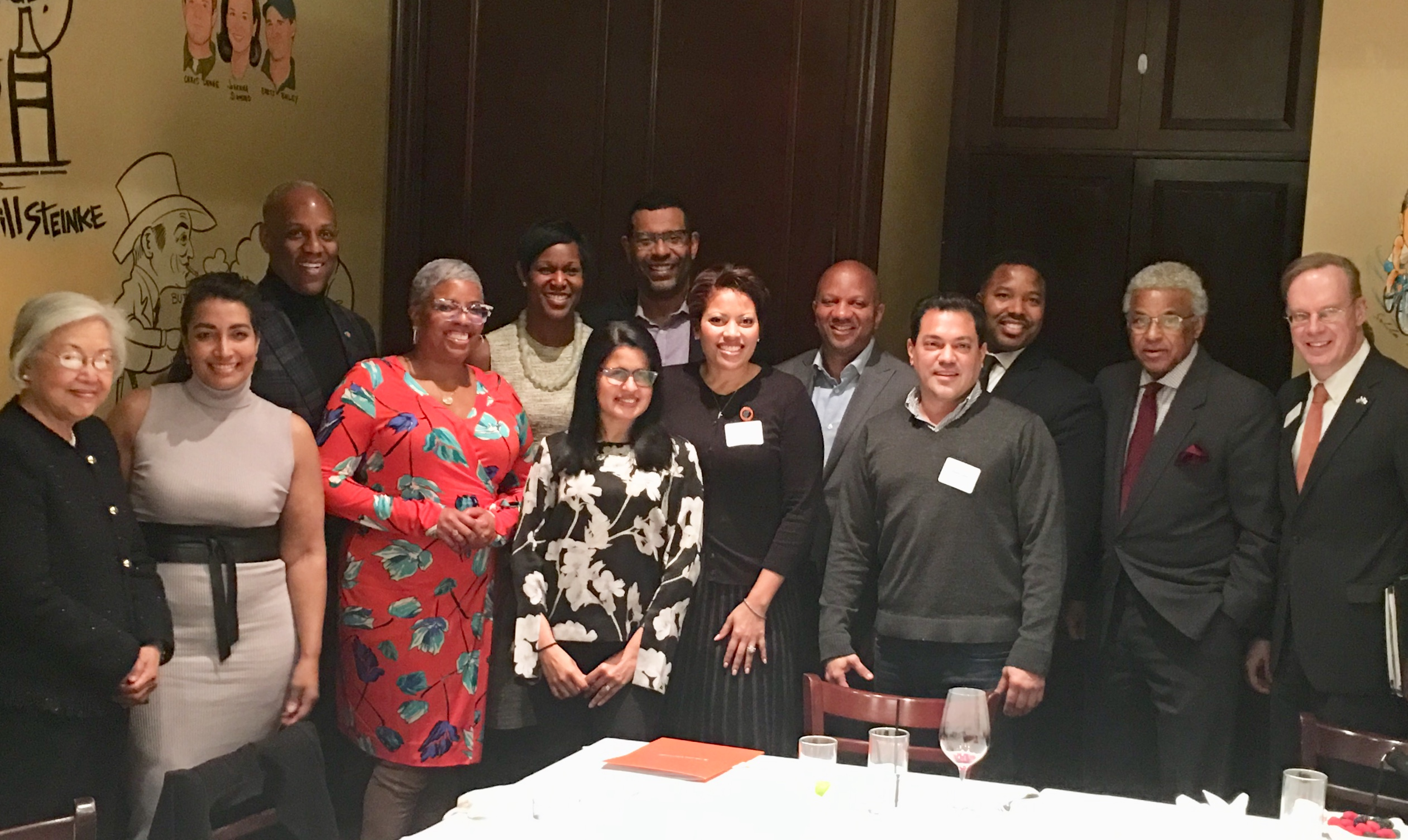 Several members of the Office of Multicultural Advancement's new alumni advisory council came together this week for a welcome dinner in New York City. Front row: Dr. Ruth Chen; Rosann Santos '95, Candace Carnage '90, Kristin Bragg '93, Rachel Vassel '91, Zhamyr Cueva '93. Back row: Victor Holman '82, Tara Brown Favors '95, Keith Brown '82, Charles Willis Jr. '90, Vincent Cohen Jr. 9'92, William (Billy) Hunter '65 and Chancellor Kent Syverud.