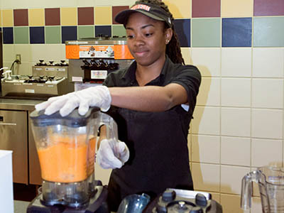 Food Services worker making a smoothie.
